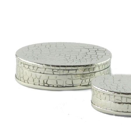 Oval sølv farvet skrin